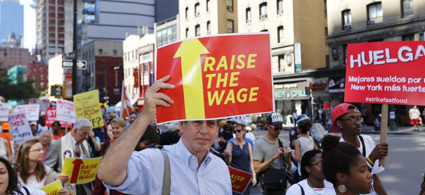 Workers rally in New York in September.