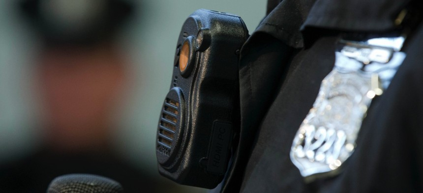 Philadelphia Police officers demonstrate a body-worn cameras being used as part of a pilot project in the department's 22nd District, Thursday, Dec. 11, 2014, in Philadelphia.