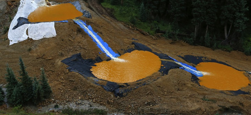 Water flows through a series of retention ponds built to contain and filter out heavy metals and chemicals from the Gold King mine wastewater accident, in the spillway about 1/4 mile downstream from the mine, outside Silverton, Colo.