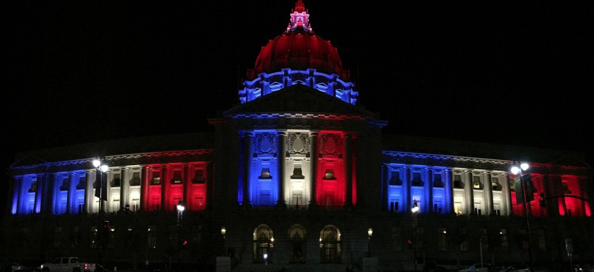 San Francisco City Hall was illuminated in the colors of the French flag following Friday's terrorist attacks in Paris.