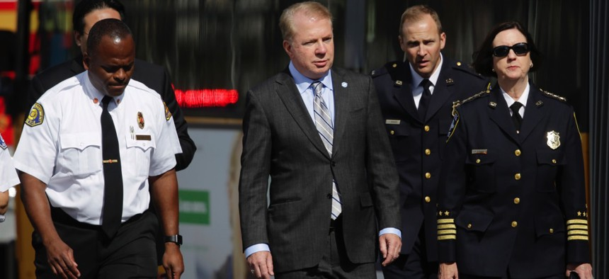 Seattle Mayor Ed Murray walks with Police Chief Kathleen O'Toole and Fire Chief Harold Scoggins at the scene of a fatal crash involving an amphibious tour vehicle and a charter bus in September.