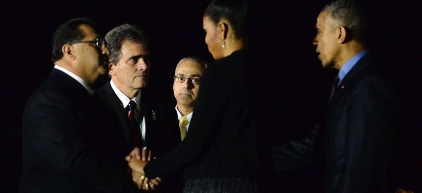 President Barack Obama and his wife Michelle greet San Bernardino County Supervisor James Ramos and San Bernardino Mayor R. Carey Davis on Dec. 18.