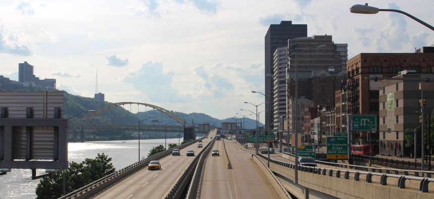 Traffic moves along Interstate 376 in downtown Pittsburgh after rush hour on a recent evening in May.