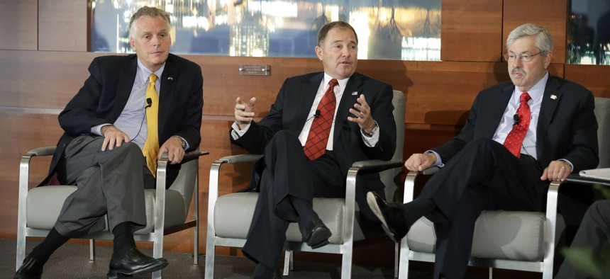 Utah Gov. Gary Herbert, center, speaks during a session at the National Governors Association meeting as Virginia Gov. Terry McAuliffe, left, and Iowa Gov. Terry Branstad, right, look on, Friday, July 15, 2016, in Des Moines, Iowa.
