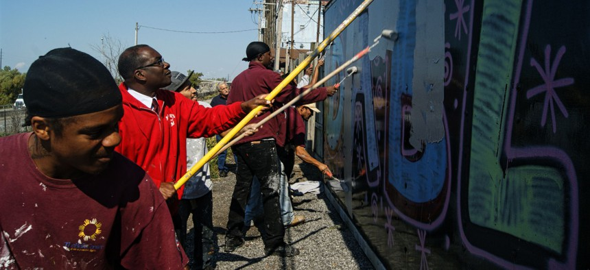 Mayor Byron Brown joins citizen volunteers to clean up graffiti in Buffalo, New York.