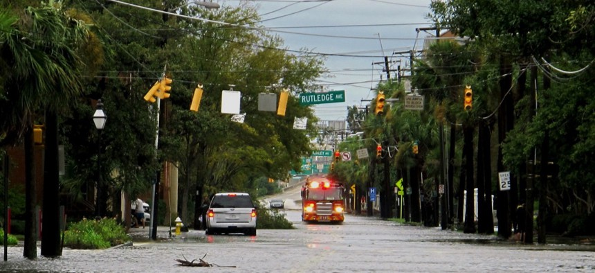 A firetruck drives through a flooded street in the hospital district of Charleston, S.C. on Saturday