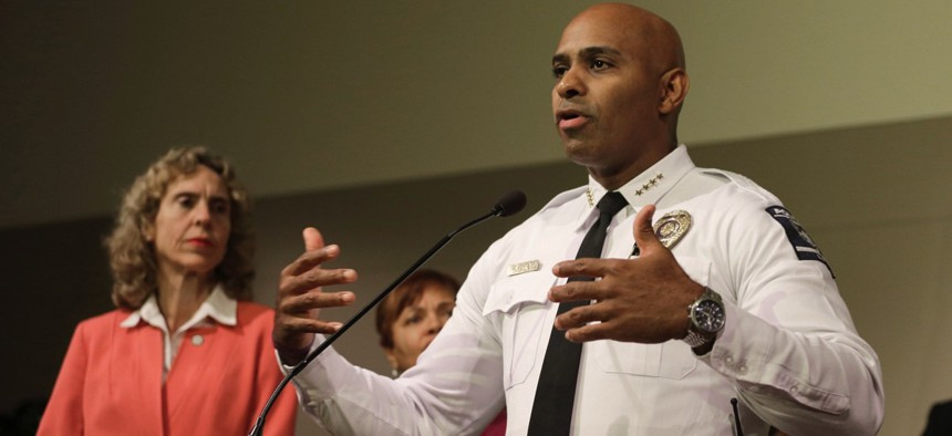 Police Chief Kerr Putney, right, gestures as Mayor Jennifer Roberts, left, watches during a news conference concerning protests over the fatal police shooting of Keith Lamont Scott in Charlotte, N.C.