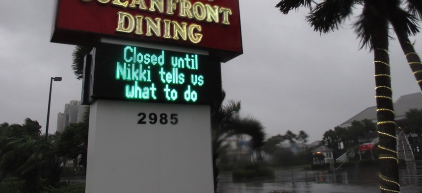 Palmettos whip beside a sign with an ironic reference to Gov. Nikki Haley along Ocean Boulevard in Myrtle Beach, S.C. on Oct. 8.