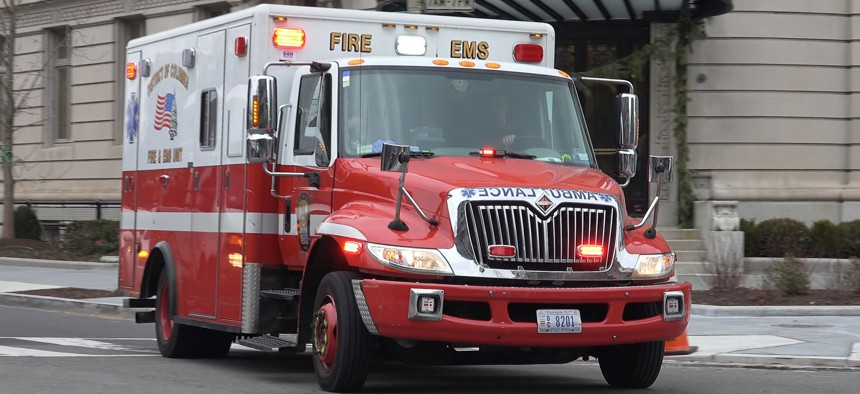 An ambulance travels through Washington, D.C.'s Dupont Circle neighborhood.