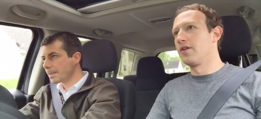 Facebook CEO Mark Zuckerburg, at right, with South Bend Mayor Pete Buttigieg