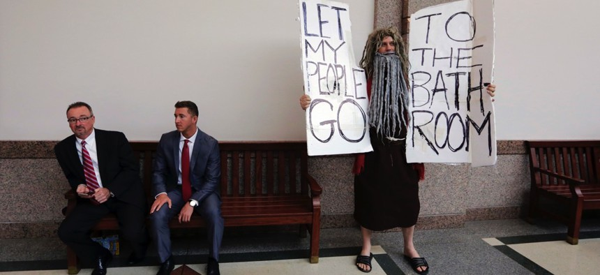 John Erler protests as the Senate State Affairs Committee begin hearings about Senate Bill 6 at the Texas Capitol.