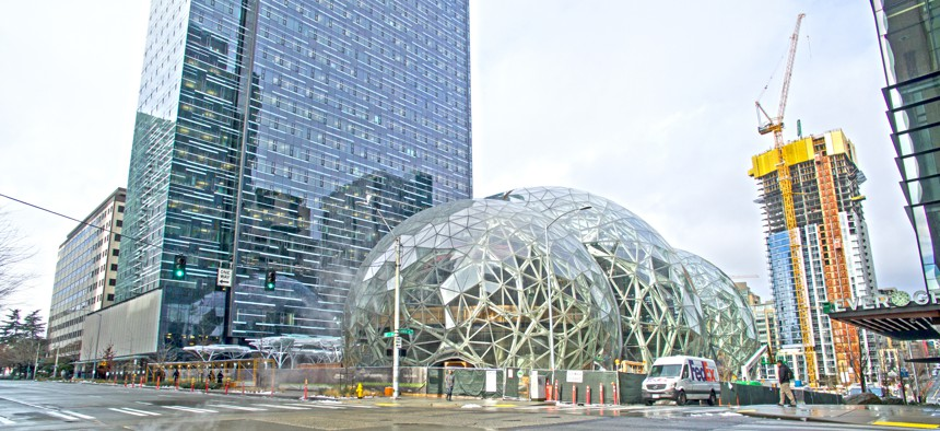 """Amazon's three glass """"biosphere domes"""" under construction in Seattle in February, 2017."""