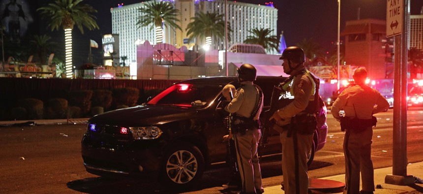 Police stand at the scene of a mass shooting along the Las Vegas Strip, Monday, Oct. 2, 2017.