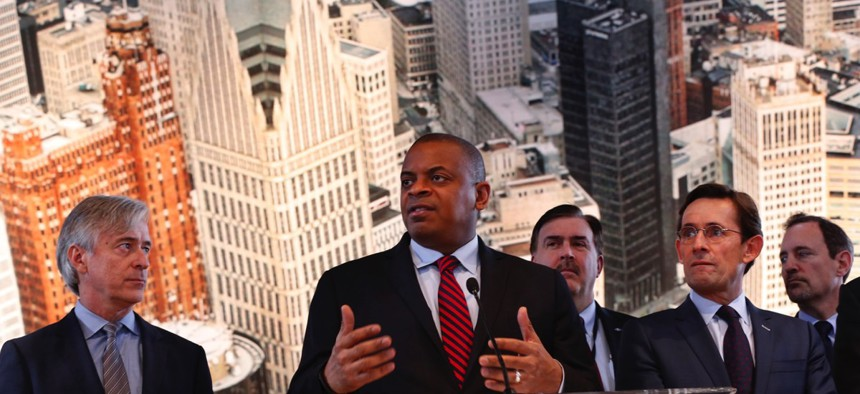 Former U.S. Transportation Secretary Anthony Foxx speaks to auto executives at the 2016 North American International Auto Show in Detroit.