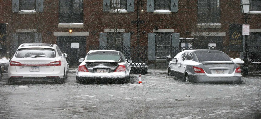 Water from Boston Harbor floods Long Wharf during Thursday as a powerful winter storm moves up the East Coast.
