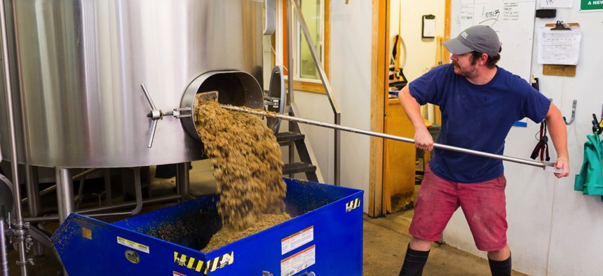 Brewer at Oakshire Brewing in Eugene, Or. making large quantities of Watershed IPA, a staple beer for this craft brewery.