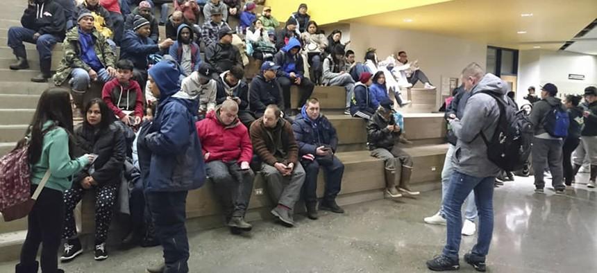 Evacuees gather at Kodiak High School in Kodiak, Alaska, Tuesday, Jan 23, 2018, after an earthquake and tsunami alert.