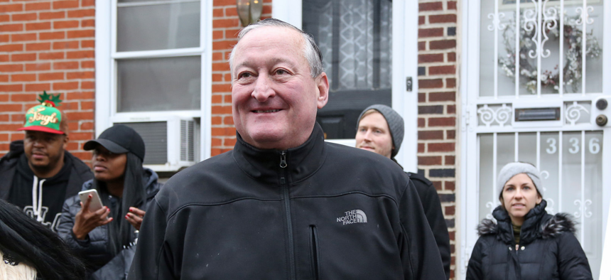 Philadelphia Mayor Jim Kenney assists with Operation Holiday Help in December.