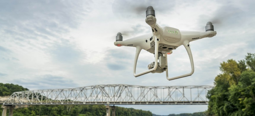 A drone flies over a river in Missouri, during 2017.