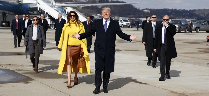 President Trump and first lady Melania Trump walk to greet supporters after arriving at Cincinnati Municipal Lunken Airport, Monday, Feb. 5, 2018, in Cincinnati.