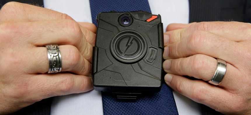 In this Feb. 19, 2015 file photo, Steve Tuttle, vice president of communications for Taser International, demonstrates one of the company's body cameras during a company-sponsored conference in Sacramento, Calif.
