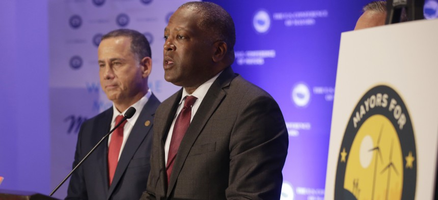 Steve Benjamin, mayor of Columbia, S.C, right, speaks during a news conference with Miami Beach Mayor Philip Levine, left, at the annual U.S. Conference of Mayors meeting, Monday, June 26, 2017, in Miami Beach, Fla.