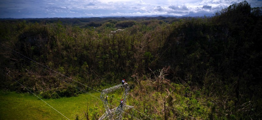 Electrical lineman work on transmission towers in October in Barceloneta, Puerto Rico.