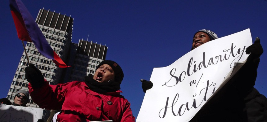 Haitian activists and immigrants protest Trump administration delays in re-registering those living in the U.S. legally through the Temporary Protected Status program in Boston on Jan. 26, 2018.