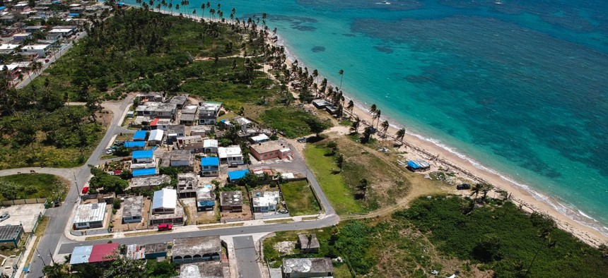 The Viequez neighborhood east of San Juan, Puerto Rico. Thousands of people across the island are still living in damaged homes, protected by blue plastic tarps, nine months after Hurricane Maria hit.