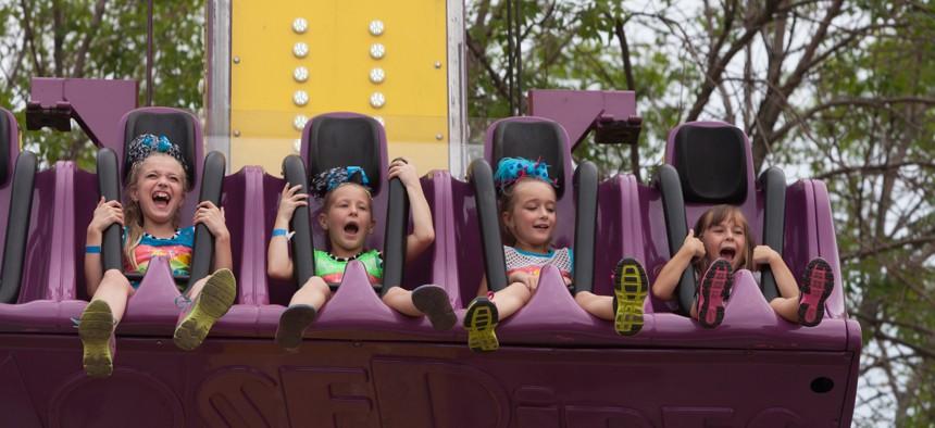 Children on a fair ride in Iowa.