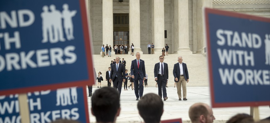 From left, Liberty Justice Center's Director of Litigation Jacob Huebert, Illinois Gov. Bruce Rauner, Liberty Justice Center founder and chairman John Tillman, and plaintiff Mark Janus walk out of the the Supreme Court on Wednesday.