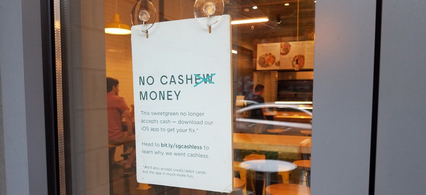 Sign in the window of a SweetGreen Restaurant in Washington, D.C.
