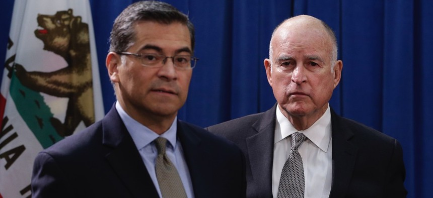 California Attorney General Xavier Becerra, left, and Gov. Jerry Brown.