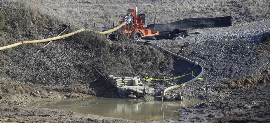 In this Jan. 14, 2016 file photo, a drainage pipe that was the original culprit of a coal ash spill is seen at the Dan River Steam Station in Eden, North Carolina.