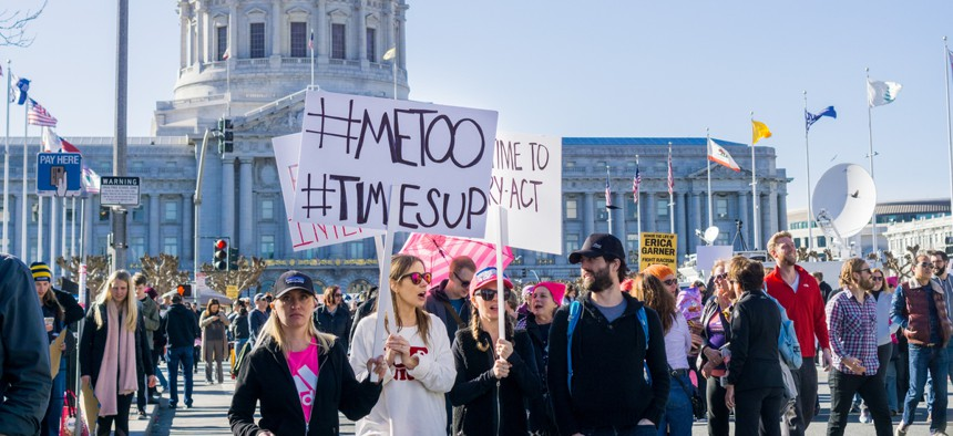 January 20, 2018 San Francisco / CA / USA - Women's March protesters begin to walk; #metoo and #timesup slogans written on a sign at the rally held in front of the City Hall.