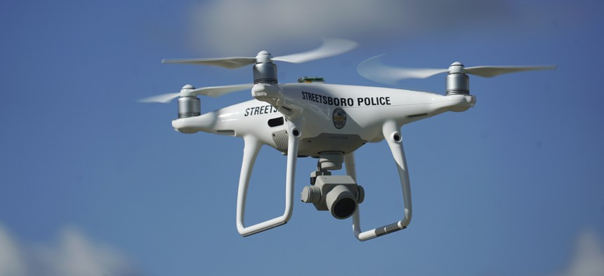 In this Oct. 16, 2017 photo, the Streetsboro police department's first drone flies in Streetsboro, Ohio.