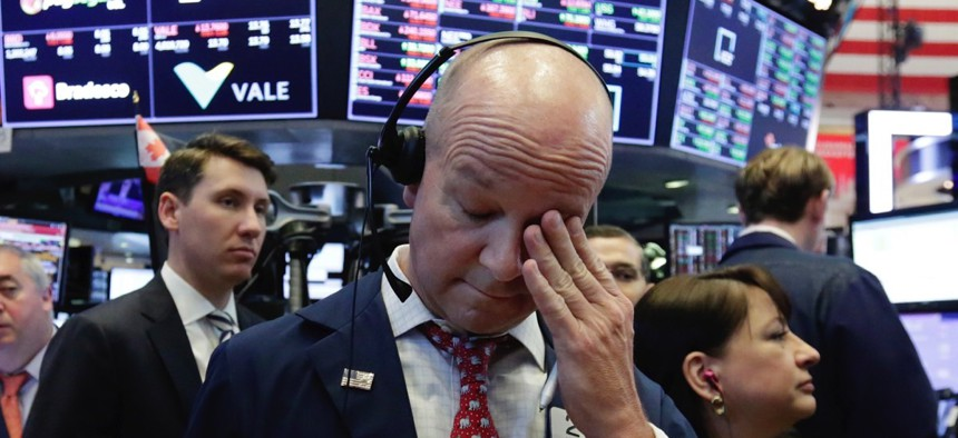 Trader Patrick Casey works on the floor of the New York Stock Exchange, Thursday, Aug. 2, 2018.