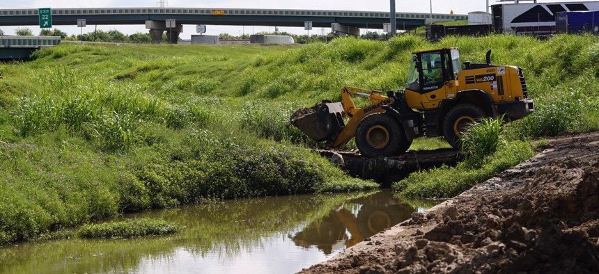Work continues along Hunting Bayou in Houston. The bayou was one of many that overflowed during Hurricane Harvey.