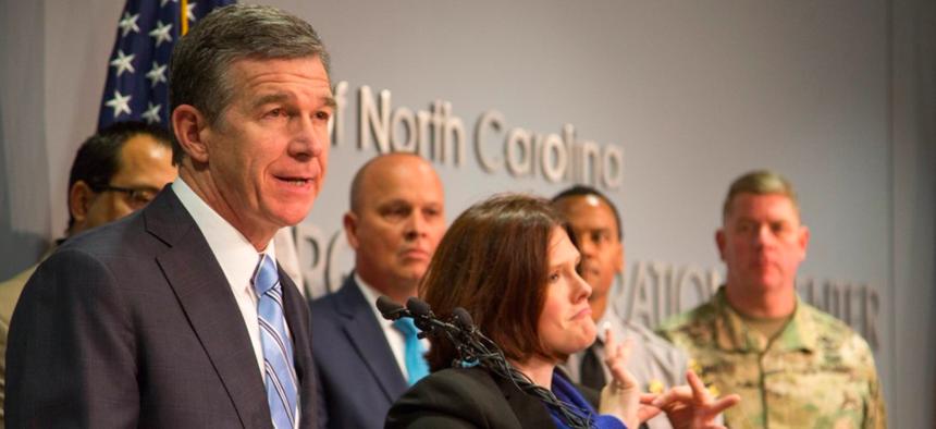 North Carolina Gov. Roy Cooper speaks during a press conference on Sunday.