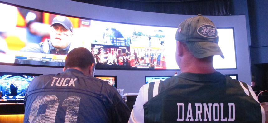 Fans of the New York Giants and Jets watch a football game on Sept. 9, 2018 after placing bets in the sports betting lounge at the Ocean Resort Casino in Atlantic City, N.J.