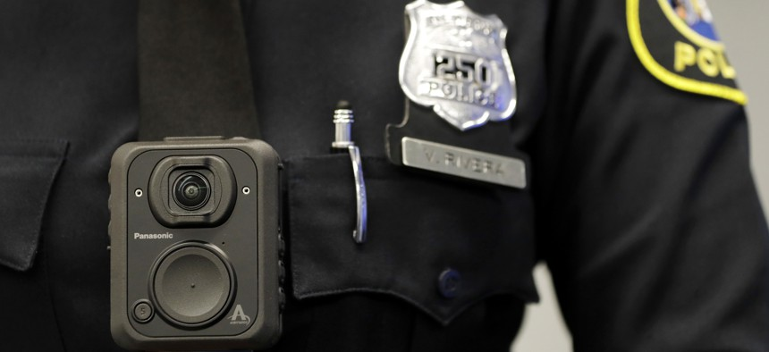 In this April 26, 2017 file photograph, a Newark, N.J. police officer displays how a body cam is worn during a news conference in Newark.