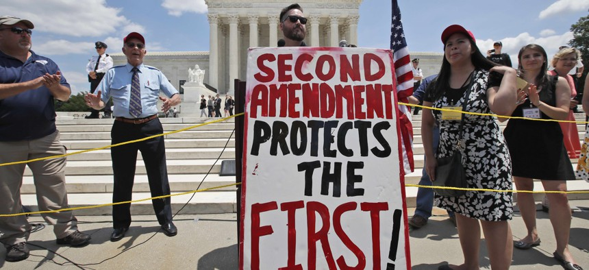 Alexander DeGarmo from Greenwood, Neb., speaks about the second amendment in front of the Supreme Court, Tuesday, June 26, 2018 in Washington.