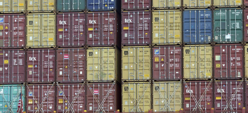 In this Thursday, July, 5, 2018 photo, a bay of 40-foot shipping container fill the stern of a container ship at the Port of Savannah in Savannah, Ga.
