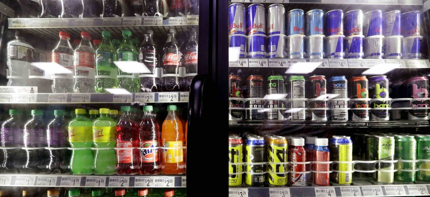 In this Monday, Oct. 1, 2018 photo, soft drinks fill a drink cooler in a convenience store in Kent, Wash.