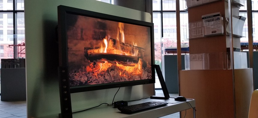 A virtual fireplace greets visitors in the lobby of the Port of Seattle headquarters on PIer 69.