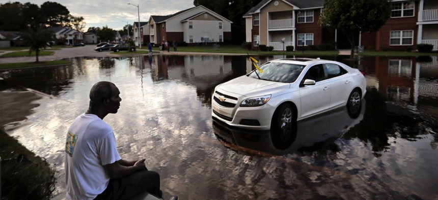 Augustin Dieudomme looks out at the flooded entrance to his apartment complex near the Cape Fear River as it continued to rise in the aftermath of Hurricane Florence in Fayetteville, North Carolina, on Sept. 18.
