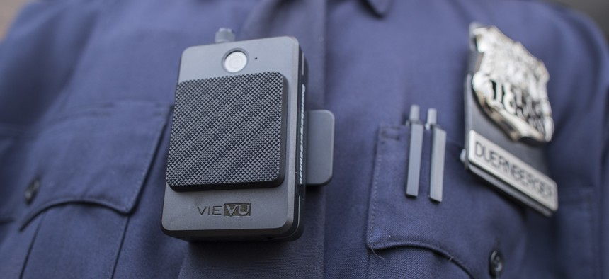 In this April 27, 2017, file photo, a police officer wears a newly issued body camera at the 34th precinct in New York.