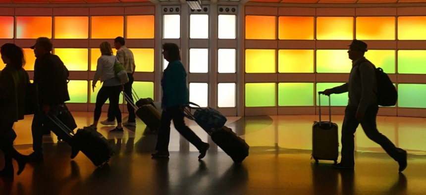 Travelers at Chicago O'Hare International Airport