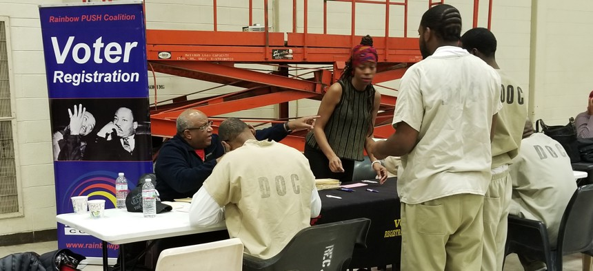 Inmates at Cook County Jail register to vote during Christmas Day services hosted by the Rev. Jesse Jackson in Chicago, Monday, Dec. 25, 2017.