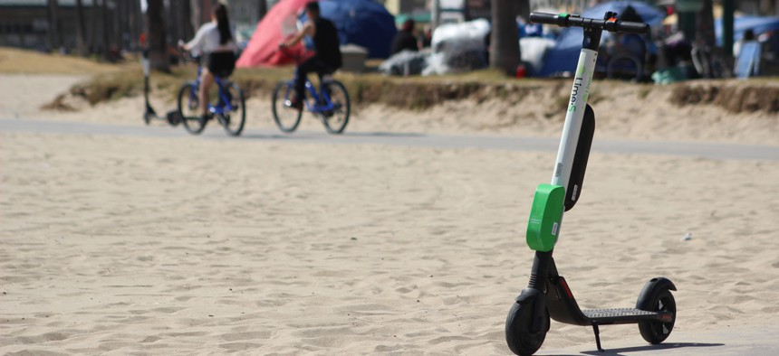 A Lime e-scooter along Venice Beach in Los Angeles.